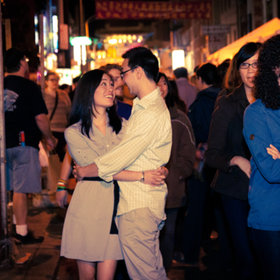 Couple holding each other in Chinatown