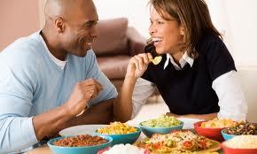 black couple enjoying food