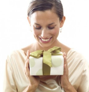 Smiling woman holding a gift