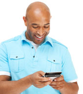Man texting and enjoying it
