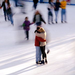 Couple hugging while ice skating