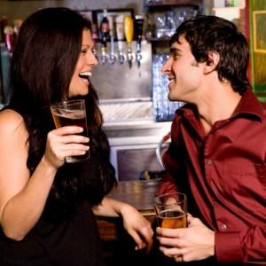 Couple enjoying drinks at a bar