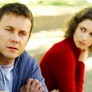 Woman Looking at a Man Sitting Beside Her