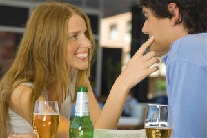 Woman flirting over drinks