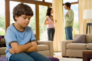 Distraught child listening to parents argue
