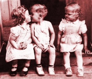 Boy kissing one girl, ignoring another