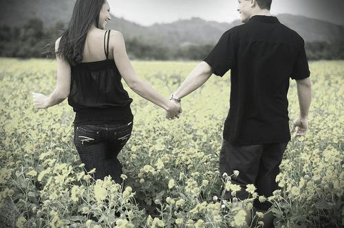 Couple walking through a field