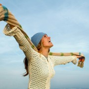 woman with her hands out to her sides being happy