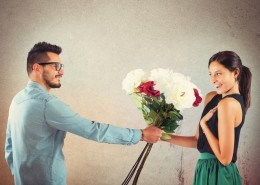 Lover boy gives flowers to his girlfriend