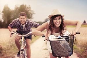 Happy couple racing on bikes