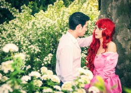 Romantic Fairy Tale Couple Sitting in Garden among Flowers in Peaceful Idyllic Setting, Prince and Princess Gazing at Each Other