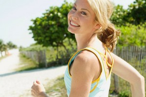 Woman jogging and smiling