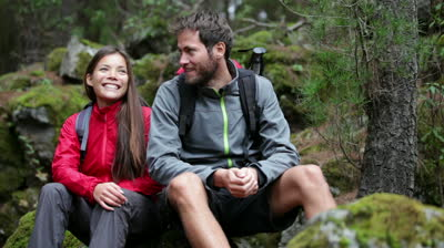 Couple taking a break from hiking