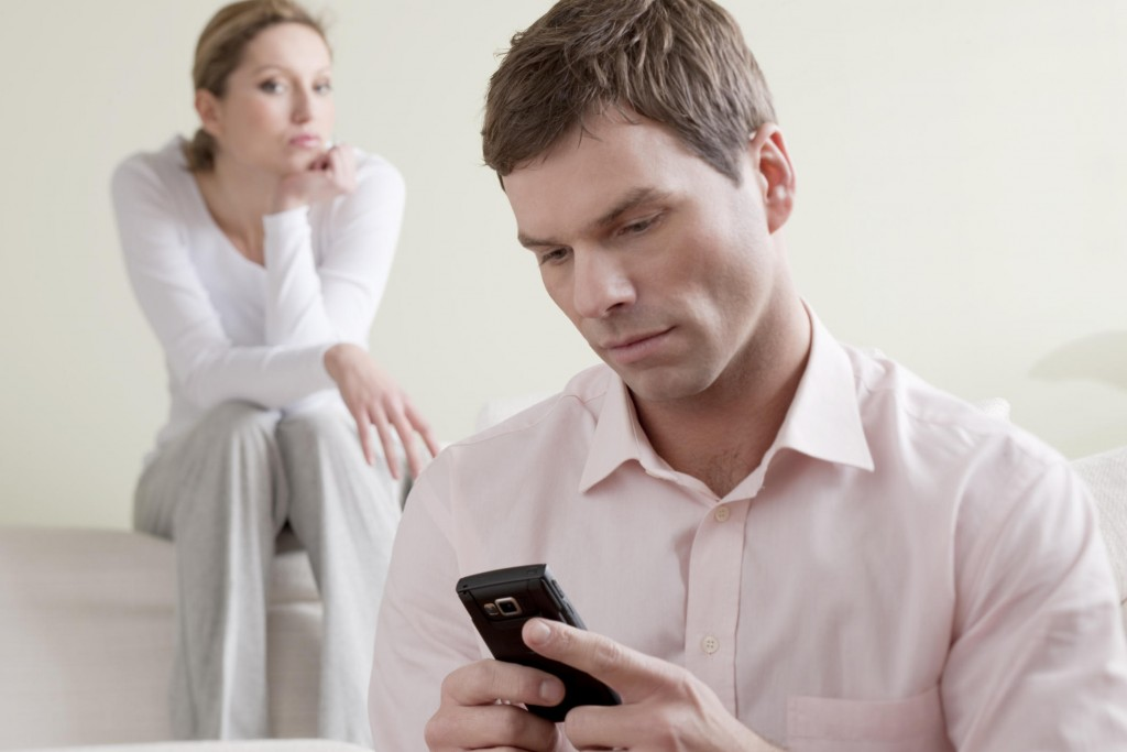Jealous woman watching man text
