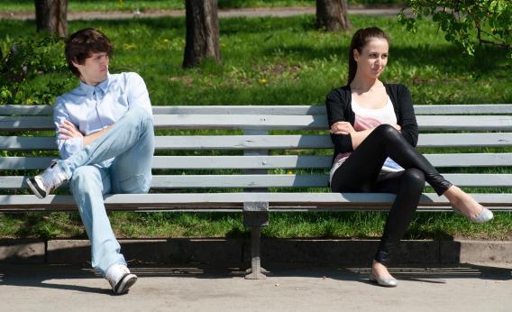 Couple sitting far apart