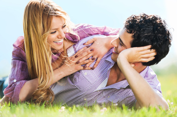 Couple lying on grass and talking it out