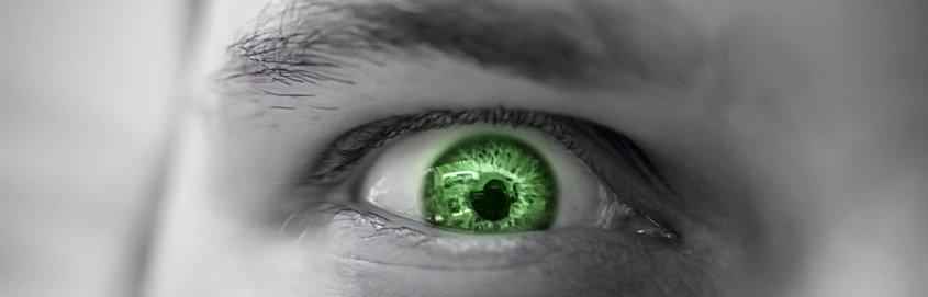 Serious sad and angry man with green eye