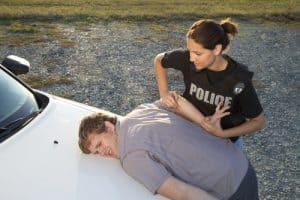 man handcuffed by woman