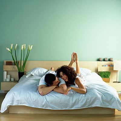 Couple lounging in bed