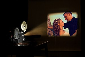 Film projector projecting a couple in love.