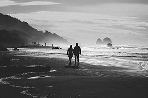 Couple walking on the beach.
