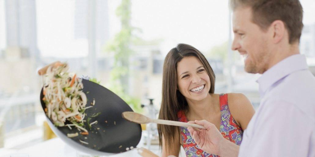 Man cooking girlfriend dinner
