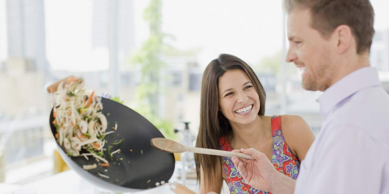 man cooking a woman a meal
