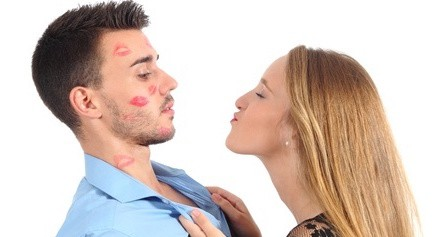 woman trying to kiss a man