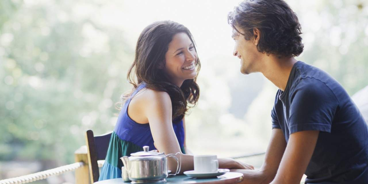 happy man and woman in conversation