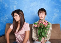girl ignoring a guy who is holding flowers