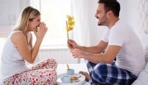 man giving wife flower
