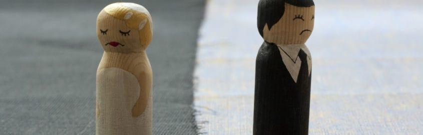 toy couple in sad marriage