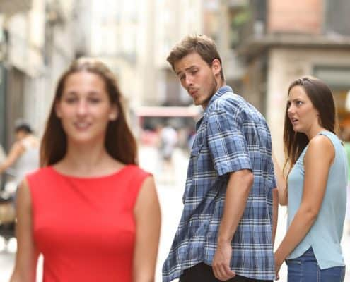 man looking at the other woman