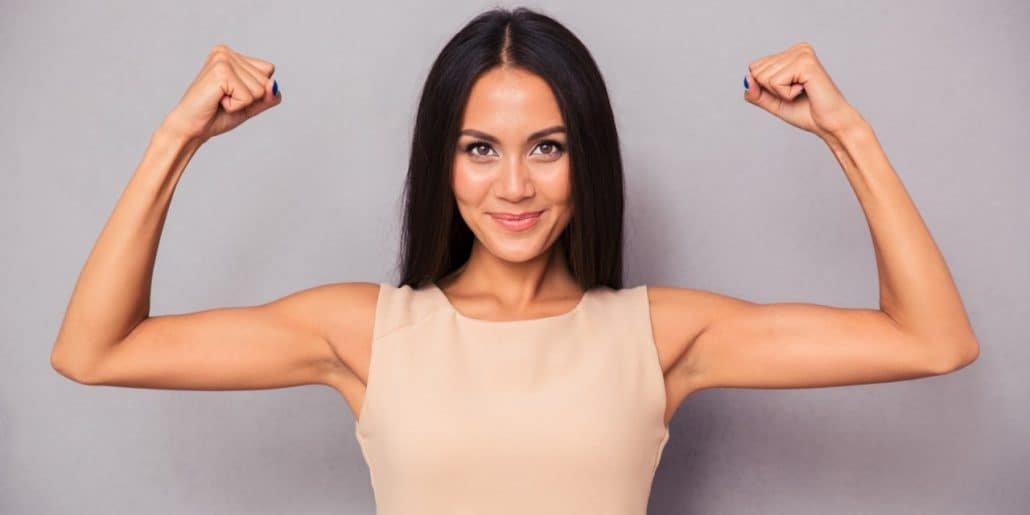 happy confident woman flexing biceps