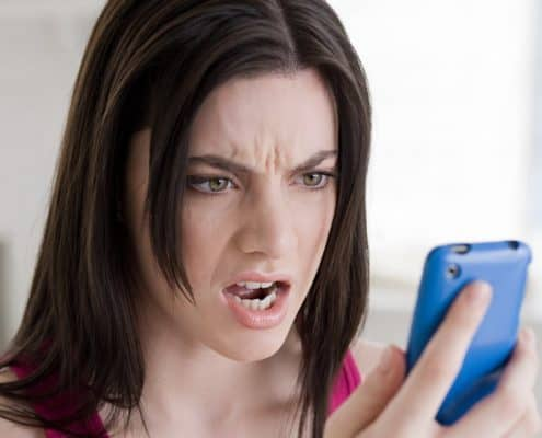 woman texting angry