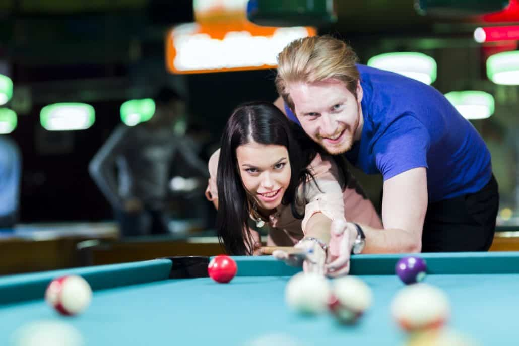 couple playing pool on date