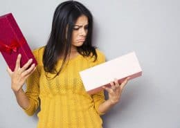 unhappy woman holding box