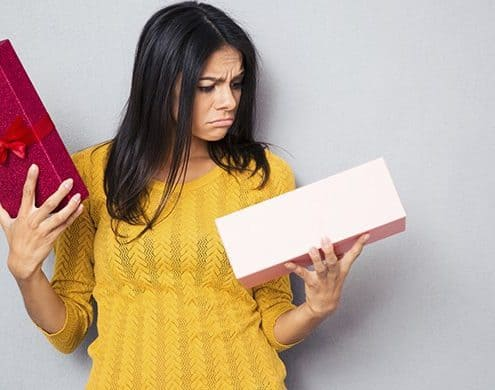unhappy woman holding box