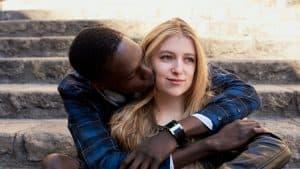 man hugging and kissing woman