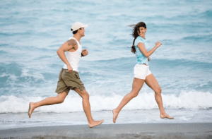 man chasing woman