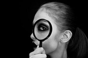 woman-looking-thru-magnifying-glass